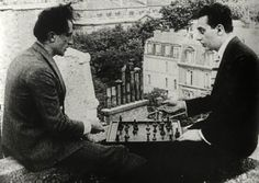 Marcel Duchamp & ManRay Playing chess on top of a building,1920s Paris