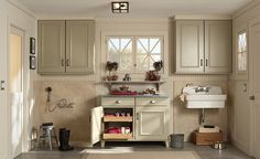 love this - the utility sink, the color of cabinets, the beadboard, the windows.
