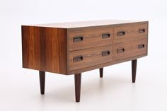 Small low drawer unit in rosewood. Designed and produced by Poul Hundevad, Hundevad Møbelfabrik, Denmark. www.reModern.dk