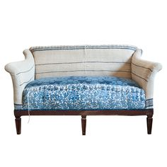 Marco Blue Settee at Found Vintage Rentals. Blue and neutral patchwork upholstered settee with various patterns and intricate stitching.