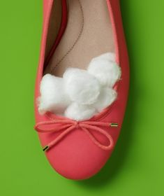 New Uses for Cotton Balls: Shoe Resizer - Give roomy heels and ballet flats a perfect fit (so you don't pull a Cinderella) by filling in the toe area with some cotton balls.