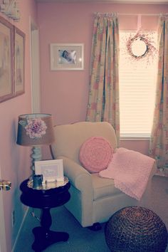 Vintage Nursery. I like the little table next to the rocker. Nice to have during those night time feedings.