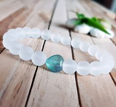 Check out this item in my Etsy shop https://www.etsy.com/listing/502156333/8mm-matte-quartz-bracelet-green-heart