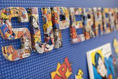 Love the comic book letters - could do using flat cardboard or foamex for cheaper? Actually could abandon difficult tracking down of white/black dotty background for photo corner and do something similar to this instead.