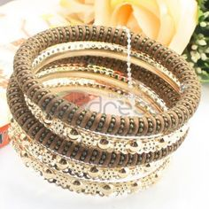 http://www.thdress.com/Brown-alloy-of-five-laps-bracelet-p13566.html