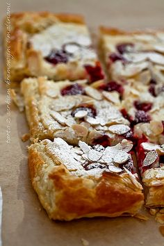 Tart with raspberries and cream cheese on puff pastry