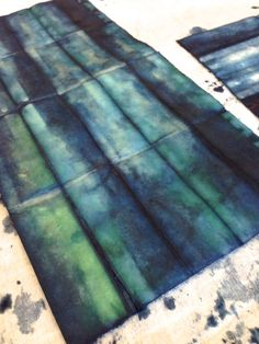 Using shibori technique to dye paper: When the paper is dipped into the dye, it comes out green at first, and then changes to that awesome indigo blue once the dye has oxidized. Sprouts Press