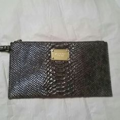 NWOT Michael Kors Wristlet Beautiful snake skin print wristlet. Never used. Just over 10 inches long. Michael Kors Bags Clutches & Wristlets
