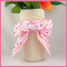 Shell Stitch Vase: This vase is made with a recycled plastic container of non dairy creamer with the plastic label removed. It is fairly easy to make and would make a great vase for a Mother's Day Bouquet of flowers!
