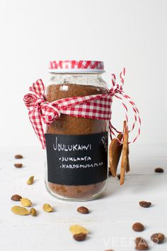 Make your coffee taste like Christmas with raw cacao powder and cardamom. Packed in little jars the seasoned christmas coffee makes a beautiful gift.