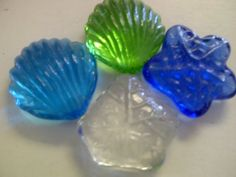 """TBC """"SHELLS & LEAVES"""" Assorted Colors Of BLUES, GREENS & CLEAR, XL Decorative Gems:Table Scatters, Vase Filler. Beautiful Unique Glass Stones NEW Size & Shapes """"X-LARGE"""" 1"""" Diam. 100% Flat Glass Gem Stones. Vase Filler, Use in Floral Arrangements, with Candles, Aquariums, Wet or Dry. Great for Eye Catching Centerpiece. Flat Stones Each Bag Aprox 14 Large Stones (Colors May Vary Per Bag) TBC HOME http://www.amazon.com/dp/B007AMKRRM/ref=cm_sw_r_pi_dp_a37gwb0A2JTW0"""