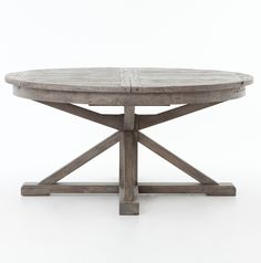 (https://www.zinhome.com/cintra-reclaimed-wood-extending-round-dining-table-63-gray/)