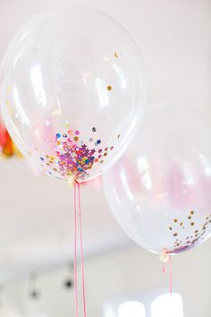 Colorful confetti-filled balloons at the party venue! Just a little sprinkle in translucent balloons. So clever!