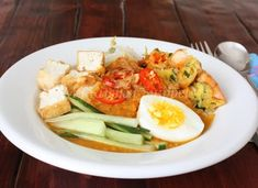 This mouth –watering mee rebus (in English, Mee rebus is literally translated as boiled noodles) is a popular dish among Malaysian and Singa...
