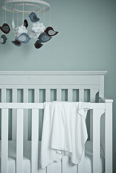 Cozy neutral baby room with handmade bird mobile and numpfer blanket