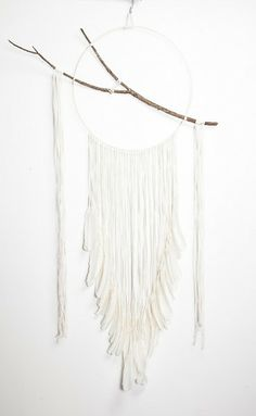 A hoop, a stick, some yarn - I could make this myself and save the $430 price tag
