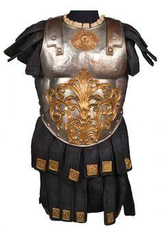 Interlocking torso armor of hand-hammered metal and navy suede from Ben-Hur