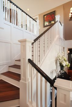 Closed tread stairs - Wainscoting adds a clean finished look to this stairwell and entry.