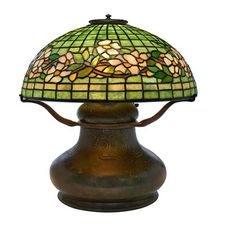 """Tiffany Studios, Dogwood table lamp: shade, no.1554 on base, no.73425, New York, NY , bronze, leaded Favrile glass, base and shade signed, great original patina, overall: 16""""w x 17""""h"""