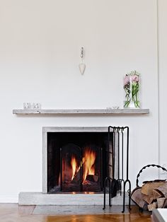 """fake fireplace: shelf and surrounding of """"fire"""" with tv behind - done Fake Fireplace, Living Room With Fireplace, Minimalist Fireplace, Round Storage Ottoman, Grey Sectional Sofa, Apartment Living, Apartment Therapy, Sunken Living Room, Tiny Apartments"""