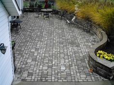 Stone Wall & Stone Patio installation by Hoehnen Landscaping in Chagrin Falls, OH