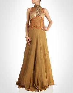 Gold floor-grazing net gown is a mesmerizing piece.SHOP NOW@ www.kimaya.in