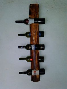 Wall wine rack for five bottles by VugecWoodworks on Etsy, €27.00