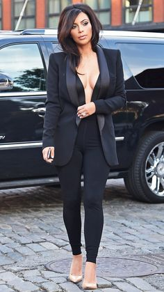 Kardashian stepped out in New York City for dinner with sister Kourtney Kardashian looking ultra glam in a sexy, all-black ensemble.
