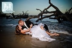 Wedding_Photographers_Jekyll_Island_GA_Driftwood_Beach_Trash_The_Dress_Session_Bride_And_Groom_In_Water