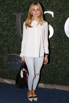 """[link url=""""http://www.glamourmagazine.co.uk/olivia-palermo""""]Olivia Palermo[/link] proves you don't have to go overboard at fancy events to look smart. We are digging her pale jeans and white blouse combo."""