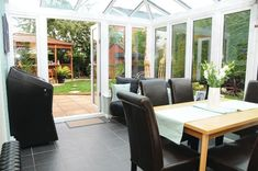Conservatories are a great place to dine, whether you're hosting a dinner party or having a family breakfast. This spacious conservatory looks ideal for quality time together Upvc Windows, Conservatories, Outdoor Furniture Sets, Outdoor Decor, Quality Time, Great Places, Interior Inspiration, Cosy, Patio