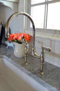 its Rohl and yes it's an investment but a bridge faucet does really look great! Notice we just did beadboard for the backsplash no tiles. We just painted it with good semi-gloss paint and it has done fine.