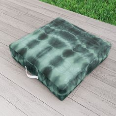 Herabl Tonic Shibori Outdoor Floor Cushion by ninamay | Society6