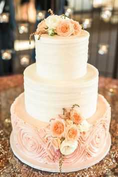 Pretty in pink wedding cake, white and peach floral cake topper, light pink icing // Helo Photography