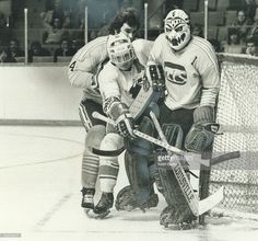 Three's A Crowd: Chicago Cougars' goalie Dave Dryden; whose face mask is fierce enough to scare most opponents; is crowded in goal crease by teammate Darryl Maggs and Toros' Steve Cuddie. Get premium, high resolution news photos at Getty Images Hockey Goalie, Hockey Mom, Ice Hockey, Hockey Stuff, Nhl, Phil Esposito, Goalie Mask, Toronto Star, O Canada