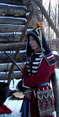 Woodland Indian Clothing Northern Great Lakes style wool hood and British coat is worn in colder weather.