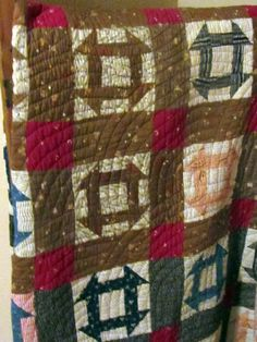 Antique Hole in the Barn Door quilt with baptist fan quilting.