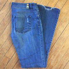 Lauren Conrad Jeans Lauren Conrad boot cut jeans - slightly distressed on pockets and bottom of legs as shown in photos. Gently worn, great condition! LC Lauren Conrad Jeans Boot Cut