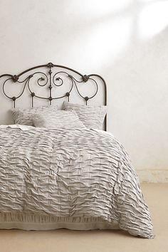 This texture//color? Either gray or cream... {http://www.anthropologie.com/anthro/product/home-bedding/26304220.jsp}