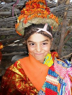 Kalasha or Kalash culture | A young girl in traditional dress during P'O festival - Chitral Valley, Pakistan.