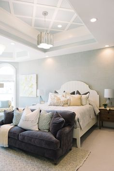 Master Bedroom. The master bedroom features white bed, tray ceiling and pillows with fabrics by Sarah Richardson.