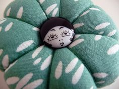 I love the flapper button! --Handmade Pincushion by English Girl at Home, via Flickr