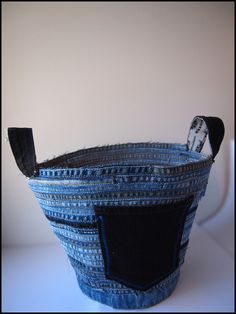 Denim-bowl  Made from the partial hems and inseams of some eight pairs of jeans (at least I think).  The handles are from a waistband.