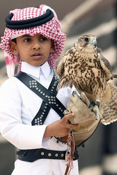 ♂ Qatari boy in traditional dress with a eagle bird