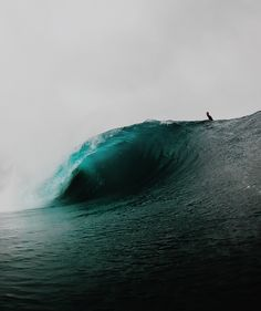 We watch as a huge perfect wave passes us by Instagram: @connorkollenda