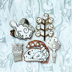 Enchanted woodland . Designers tagged in the photo . . [Image description: 5 enamel pins on marbled paper. The pins are a cloud cat by @xhilyn  a plant with faces by @kayeblegvad  a broken column by @shinyapplestudio  a sleeping deer by @reicheruart  and a mushroom girl by @gildedcreaturesart ] . . #enamelpins #lapelpins #pingame #pinstagram #enamelpin #lapelpin #hardenamelpin #pinart #collector  #pin #pins #pinbadge #pincollector #pincollection #pincollage #pinaddict #pinsofig  #hatpin…