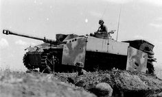 A German StuG III with armored side panels added