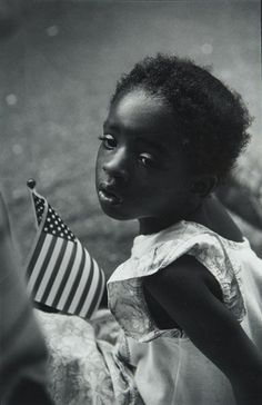 GIRL WITH FLAG   1991   Photography by Earlie Hudnall, Jr. Master African American Photographers Series 3 of 6.