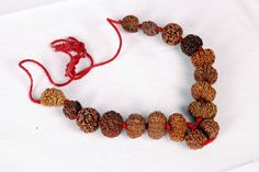 Nithya Mala Shop At:http://www.nithyanandagalleria.com/index.php… Nithya Mala is very powerful mala which completes all your incompletions  and helps you overcome self doubt self harted and self denial. Nithya Mala benefits with 16 different varieties of Nepal Premium Rudraksha Beads knotted in red thread Beads: 1 to 14 mukhi beads, Ganesha Rudraksha, and Gauri Shankar Rudraksha (Nepal Premium Big Beads) This is an ultimately powerful bead combination