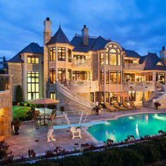Castle-like house with stairs leading down to pool